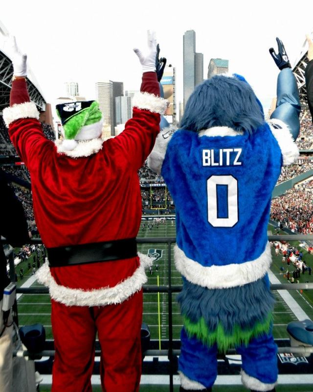 Santa and Blitz cekebrate another Seattle Seahawks Win