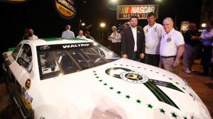 DAYTONA BEACH, FL - FEBRUARY 14: (L-R) Owner of Swan Racing Brandon Davis, Michael Waltrip, and Sandy Hook Fire Chief Bill Halstead pose for a photo at the unveiling of the #26 car to benefit victims of the Newtown, CT shooting at the 2013 NASCAR media day at Daytona International Speedway on February 14, 2013 in Daytona Beach, Florida. (Photo by Jonathan Ferrey/Getty Images)